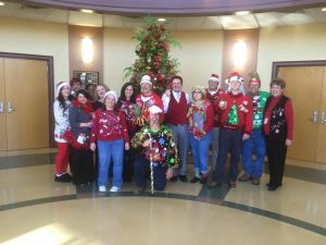 1st Annual Ugly Sweater Contest Contestant and Judges